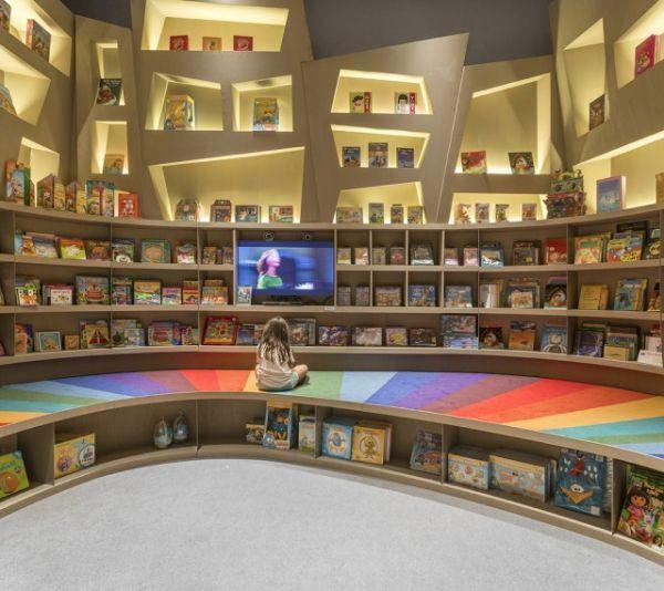 this beautiful bookstore looks like a long winding rainbow neatorama