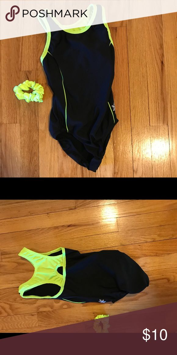 Snowflake Leotard with matching scrunchie This is a black leotard with some neon yellow it's company is snow flake. It comes with a matching neon yellow scrunchie it has a little pilling but otherwise it is in great condition Other