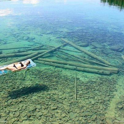 Because of the crystal-clear water, Flathead Lake in Montana seems shallow, but in reality is 370 feet in depth