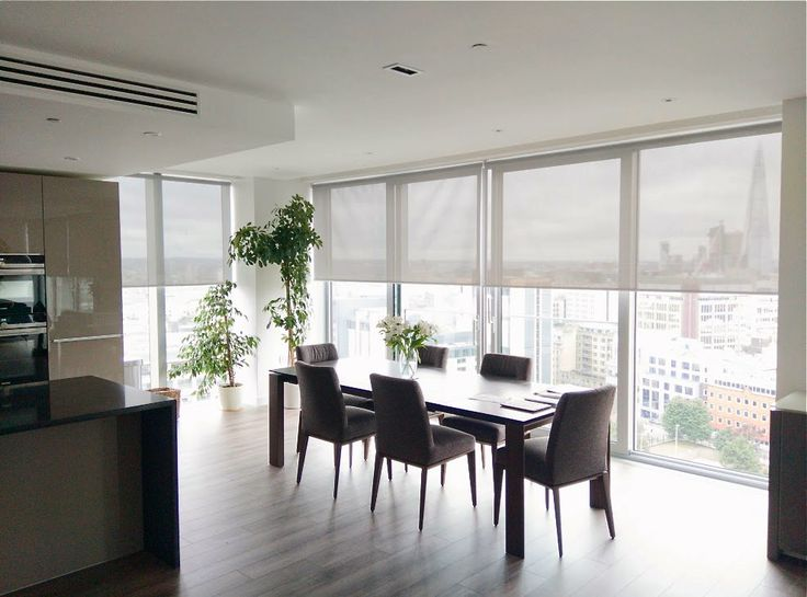 Sunscreen Roller Blinds In Steel Colour Fitted To Floor To Ceiling Windows  For A Penthouse Apartment