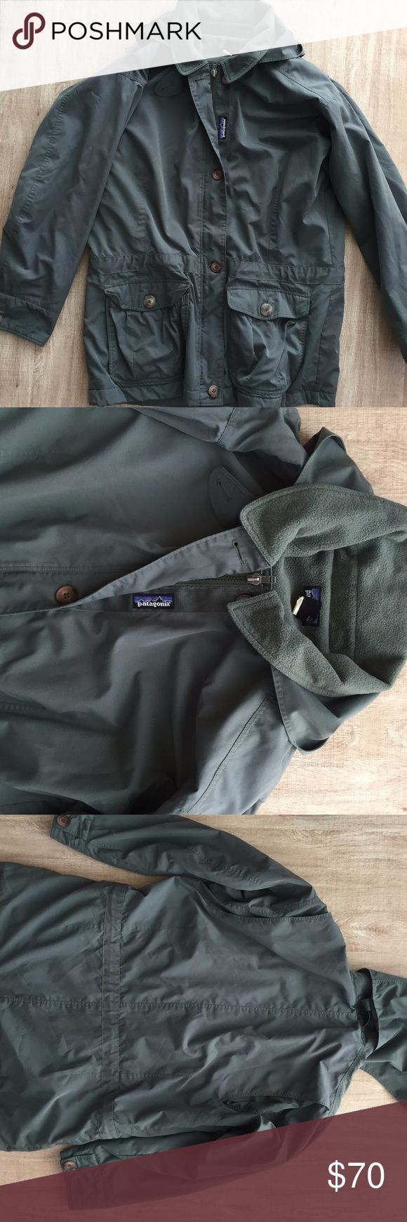 "Patagonia Parka Fleece Lined Jacket Green Cargo M Patagonia military cargo Parka Women's size Medium (Can Fit Large)  great pre owned vintage condition Features four exterior pockets as well as one interior 100% polyester fleece lined interior for warmth Button and full zip up front Removable hood only flaw to mention is some slight red discoloration on lower side seam near left front bottom pocket (see photos) No holes or rips Worn with plenty of life left!  Measurements 32"" base of collar…"