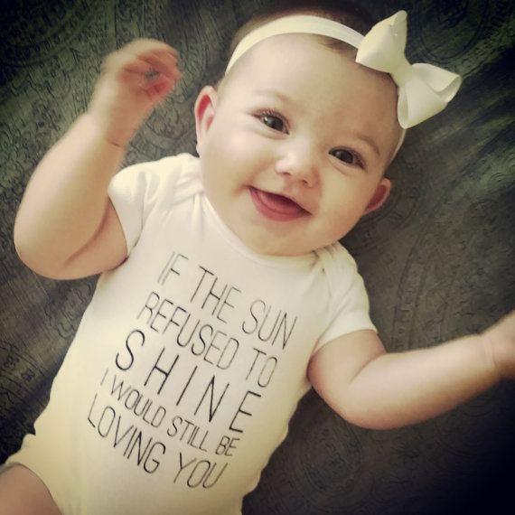 This 100% cotton onesie features the lyrics If the sun refused to shine, I would still be loving you. from Led Zeppelins song Thank You. It