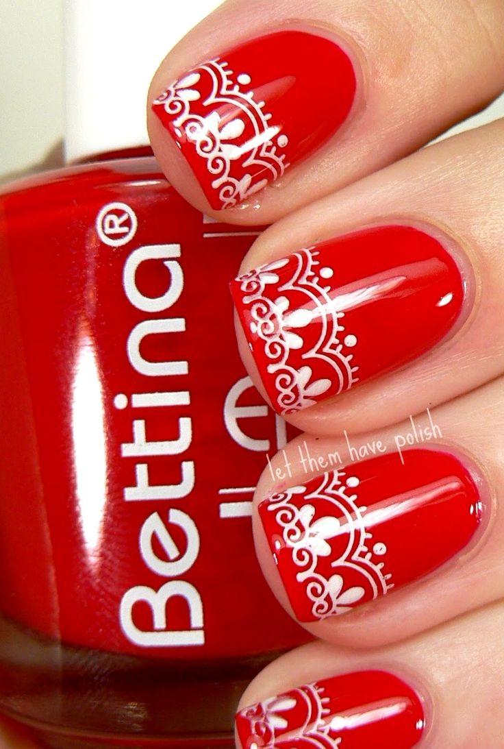 Red white nail art design..