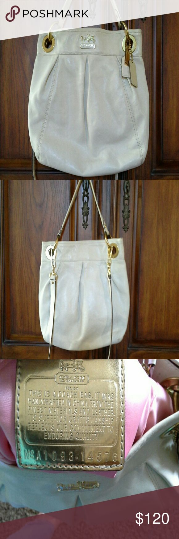 Beautiful  Authentic leather COACH purse Off white color with goldtone rings, pink liner. Inside has some marks, outside  is in pretty good condition. Has long strap. Coach  Bags Totes