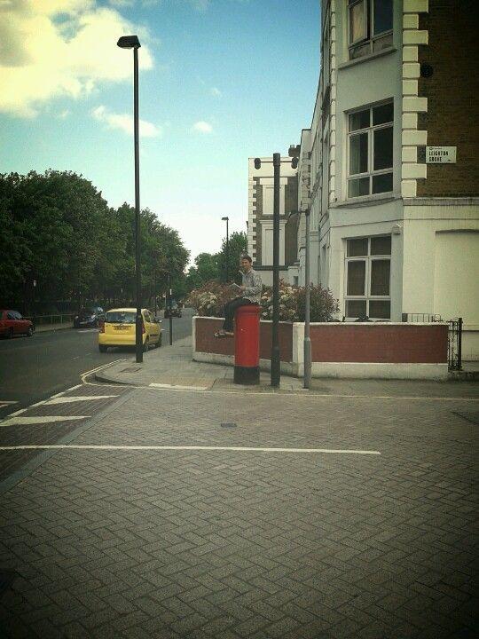 Man on postbox Kentish Town