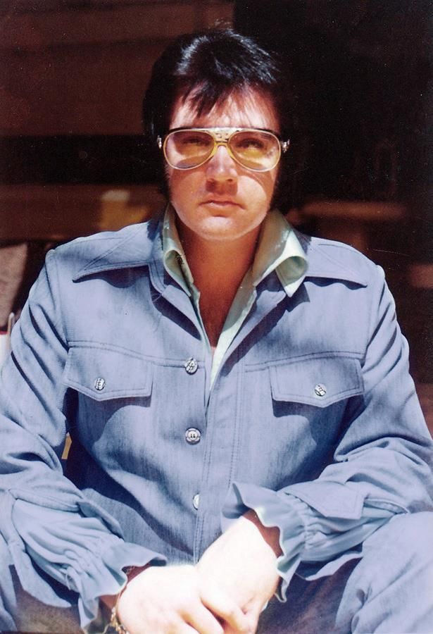 """3rd Feb 1976 - a somber looking ELVIS at his Graceland Mansion on the day he recorded 'Solitaire' in the Jungle Room for the Elvis Presley Boulevard L.P.  The """"den off the kitchen"""" was not named the Jungle Room until after Elvis passed away."""