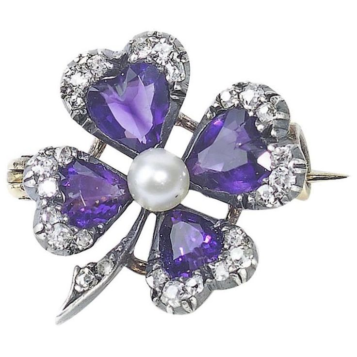 A Victorian Amethyst and Diamond Four-Leaf Clover Brooch with a natural Pearl in the centre, with four pear shaped Amethysts, edged with old-cut Diamonds in cut down settings, mounted in Silver-upon-gold. English, circa 1890.