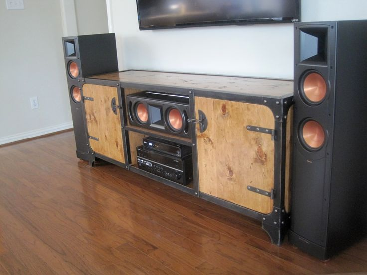 Modern Industrial media console with Klipsh speakers. Features handscraped wood, steel frame construction and hand built to customer's requested size.