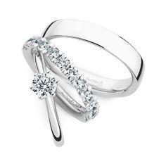 Trouwringen 18 Krt Witgoud 12 Briljanten. Elke trouwring wordt vervaardigd in verschillende edelmetaallegeringen. Zo kunnen bv meerkleurige ringen ook besteld w