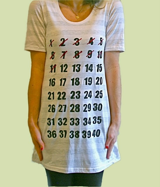 """What a clever shirt to take a pregnancy photo in each week. I like that the shirt starts out huge and you can """"watch"""" your belly grow into it! I will have to remember this for next time."""