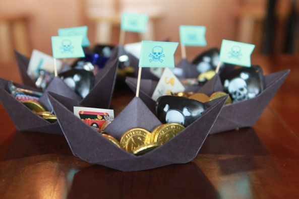 Pirate favors (kcommunicated.com): Fun for a nautical, under the sea, pirate, fishing, or other theme---paper boat with thematic treats inside