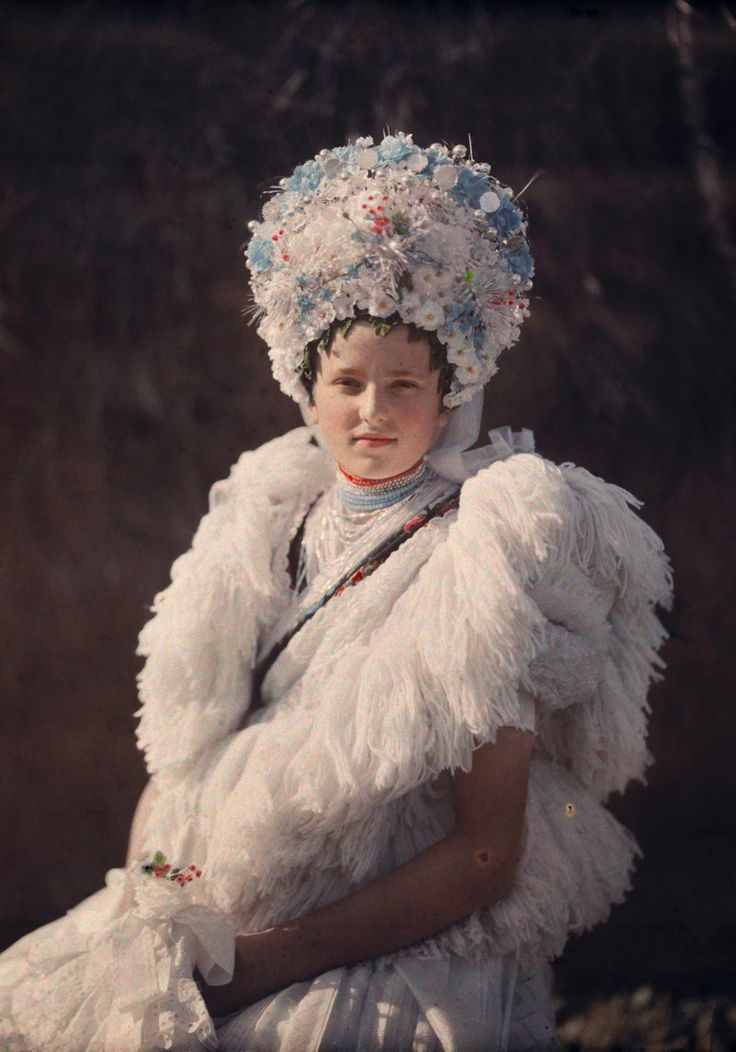 A girl poses in festive attire in Mezokovesd, Hungary, around 1930. The portrait was taken with autochrome, the first viable method of color photography, which required an unusual ingredient—potato starch.