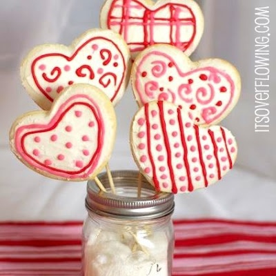 COOKIE BOUQUET  Sugar Cookie Cutouts  1/3 cup butter  1/3 cup shortening  3/4 cup sugar  1 teaspoon baking powder  1 egg  1 teaspoon vanilla  2 cups all purpose flour    Preheat oven to 375.  Beat butter and shortening on medium to high for 30 seconds.  Add sugar, baking powder, and a dash of salt.  Beat until well combined.  Beat in egg and vanilla.  Beat in the flour.  Chill dough for until it's easy to handle {2 hours}.  Lightly flour your prep surface.  Roll the dough 3/8 inch thick…