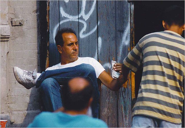 1993 picture of Genovese soldiers Carmine Russo and Elio Albanese (balding guy), selling illegal fireworks on Mulberry Street. They were part of a crew who ran the rackets overseen and controlled by capo Allie Malangone and from time to time handle the enforcement of debt collections and heists like burglaries or bank jobs.