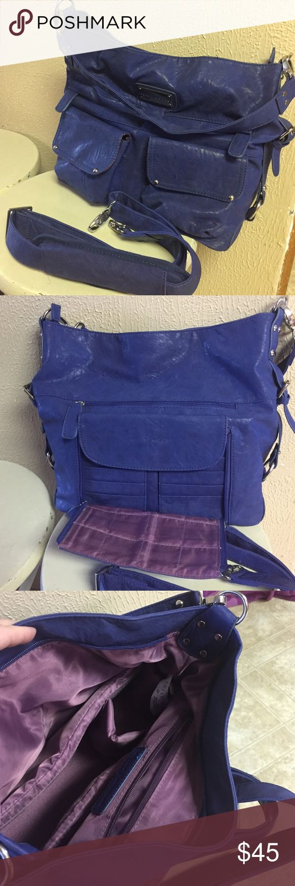 Kelly Moore Two Sues Bag Kelly Moore Two Sues bag in blue. Comes with a short shoulder strap & a long padded cross body strap. Two flap pockets & 2 zip pockets on one side & a large zip pocket  and Posey pocket on the other side. Has a removable padded basket with Velcro dividers to protect camera gear. 12(w) 13(h) 5(d). Very user friendly Bag. Gently used & still has a long life left. Kelly Moore Bags Shoulder Bags