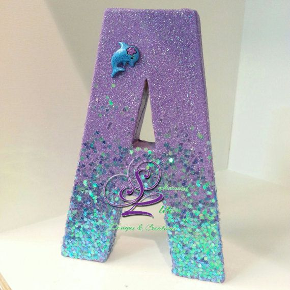 Sophisticated Life Designs presents a Classy Sea Girl Mermaid theme customized letters for a mermaid theme birthday party, girls birthday party or baby shower. You can celebrate by adding these customized letters to your childs birthday party or bedroom wall to add a touch of sophistication. Letters can be personalized to match your theme, childs name, and colors choices. Letters shown in photos are 12 tall and stand alone (no propping necessary-except F, P,). ALL EMBELLISHMENTS SUBJECT TO…