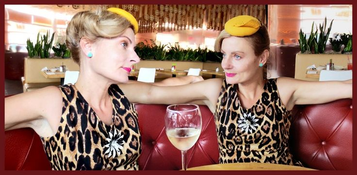 1940s roll hair style with felt swiss cheese fascinator hat, leopard dress in a 1950s style diner before seeing the 1980s band OMD in NYC.