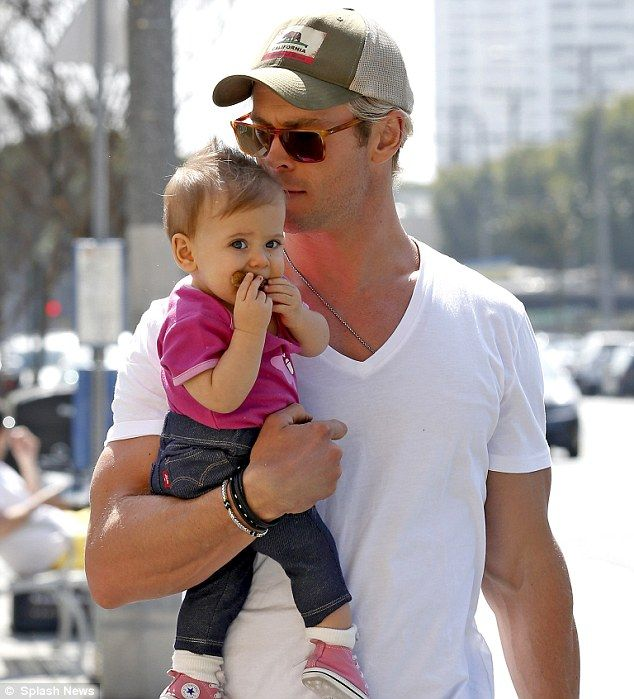 Doting dad: Chris Hemsworth kissed daughter India Rose Hemsworth while out in the Venice Beach, California area on Saturday