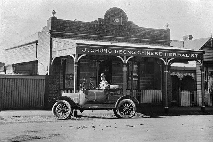 """James Chung Leong in Model T Ford car outside """"J. Chung Leong Chinese Herbalist"""" in Ballarat,Victoria in 1920."""