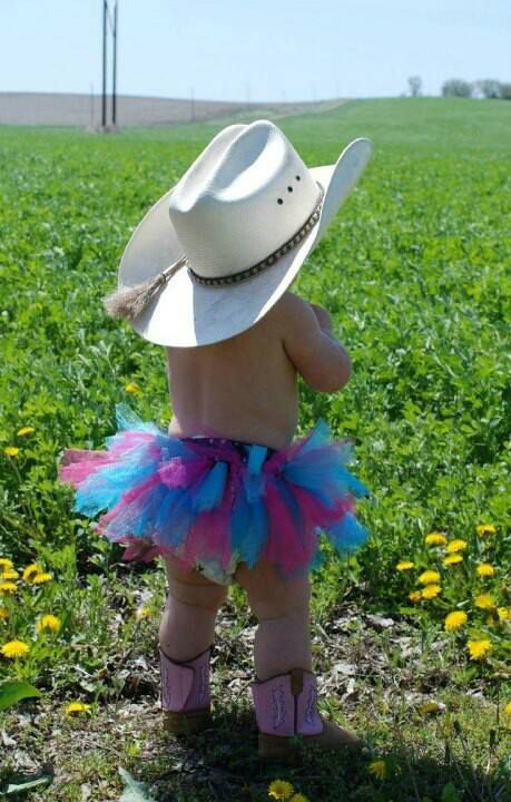 Cowgirl With A Tutu Cowboy Boots And Cowboy Hat