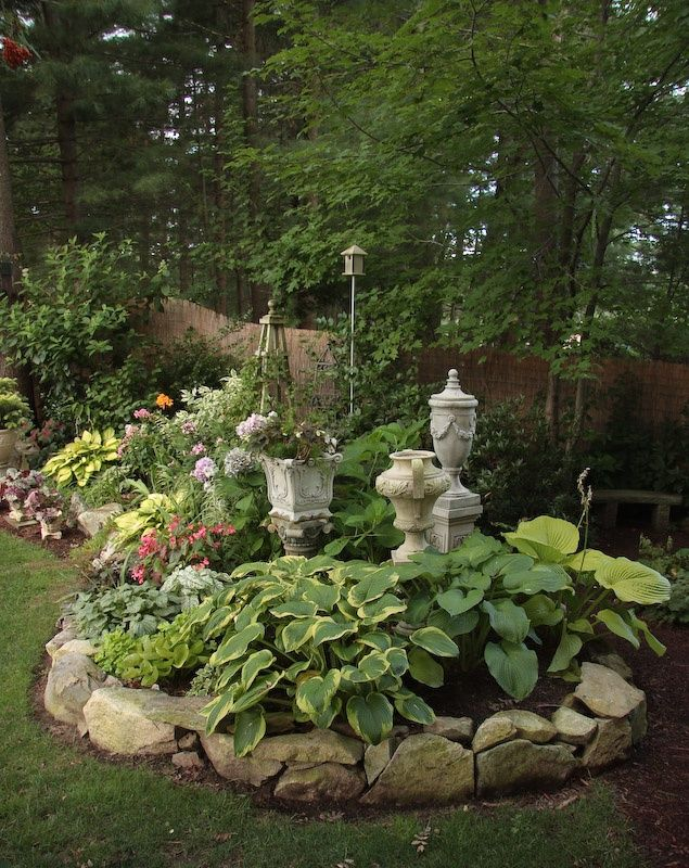 Shade garden raised beds with stone edging