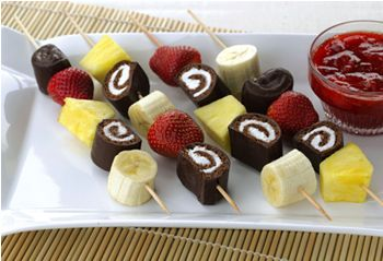 Fruit kabobs with hostess cakes....
