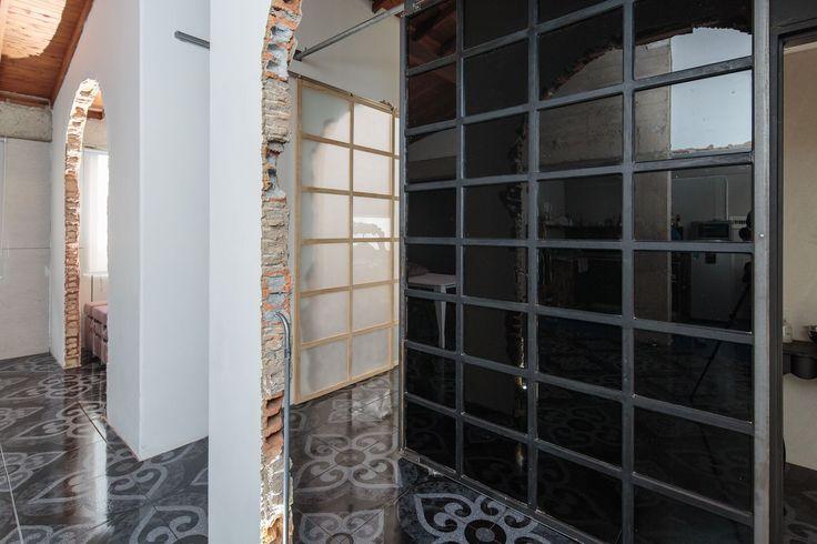 Industrial black glass and iron sliding door
