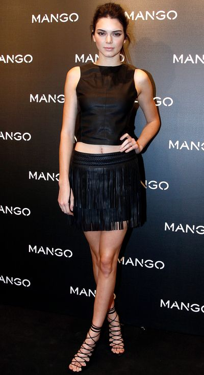 Kendall Jenner in a crop top and fringe skirt by Mango