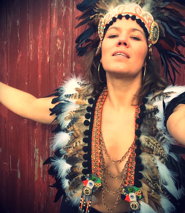 Dancing Warrior Woman. Feather and chain festival breastplate/feather collar/feather capelet. www.wildthing.com and https://www.etsy.com/uk/shop/feathersandthreaduk