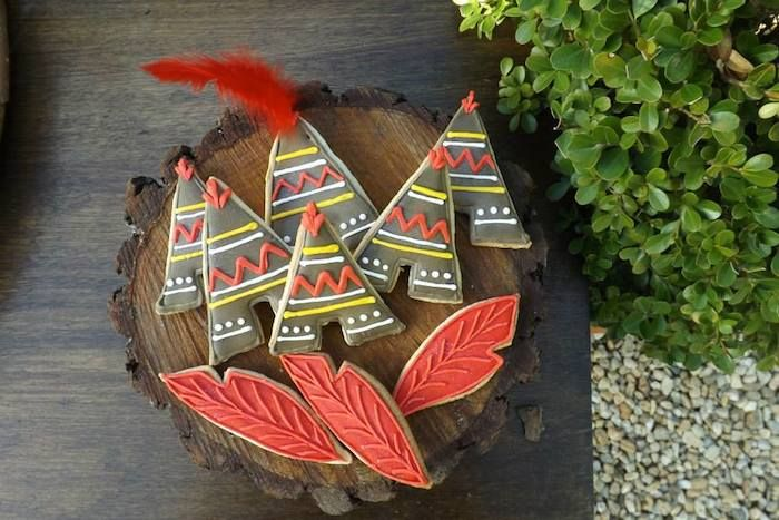 Teepee and feather cookies! Peter Pan + Neverland themed birthday party KarasPartyIdeas.com