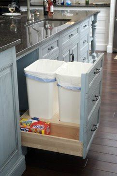 Having a pull out cabinet for a trash can is nothing all that new, but how great would it be to have one for trash, one for recycling, AND a place to store your trash bags?