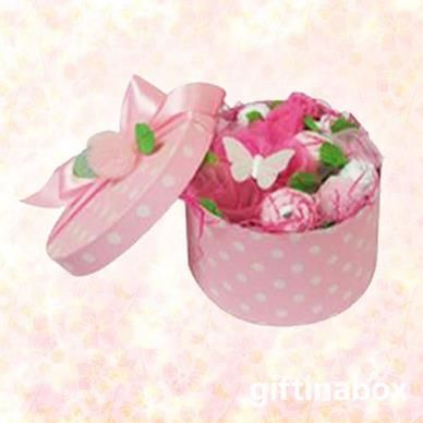 A beautiful posy of white and pink babywear for the new arrival. All presented in a classic hat box with pink wrapping and ribbon   1 vest 2 face cloths 1 leggings 1 beanie 1 pair of booties 1 bib decorative flowers decorative butterflies