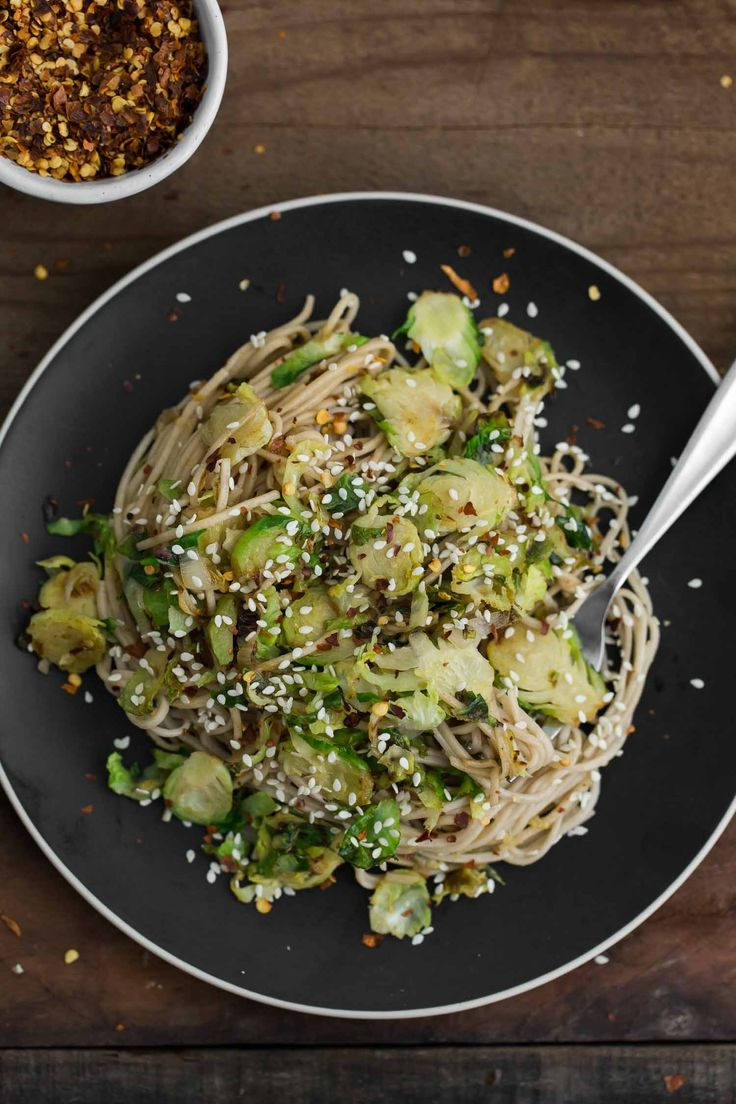 An easy and beautiful soba bowl featuring thinly shaved sesame brussels sprouts tossed with a ginger-soy sauce. A perfect weeknight dinner.