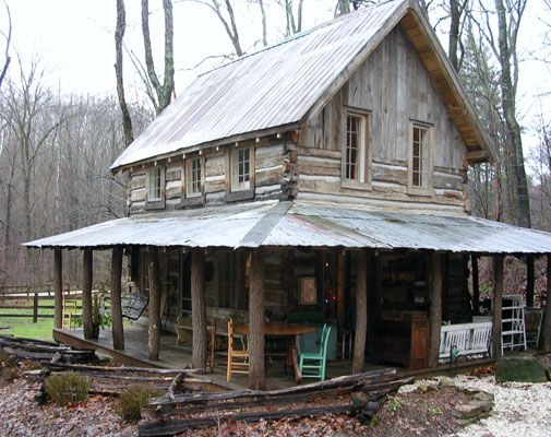 restored 150-year-old tiny cabin with a big porch! I want to live there!