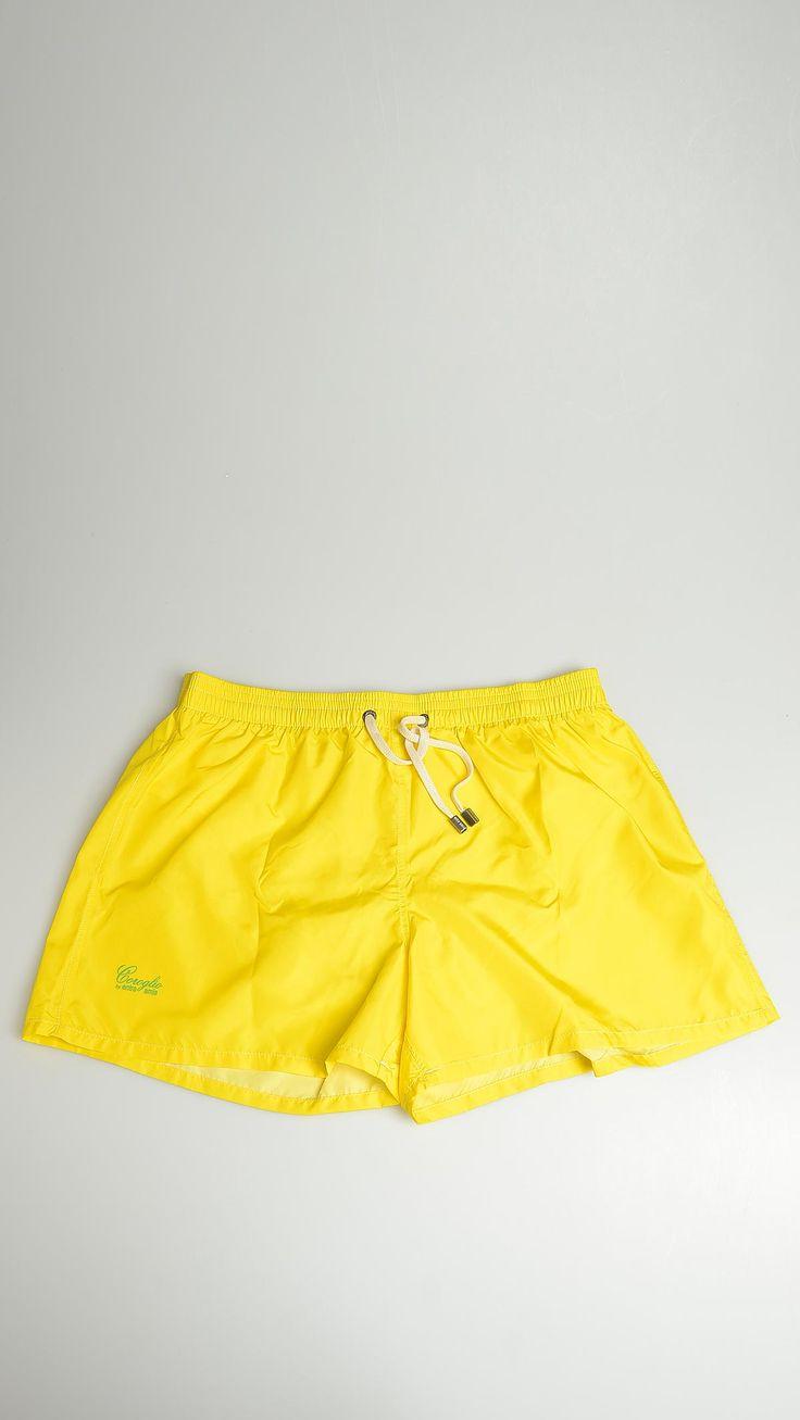 Plain yellow swimsuit featuring inner mesh slip, one patch pocket at back, metallic eyelet detail, elasticized waistband, 100% nylon.