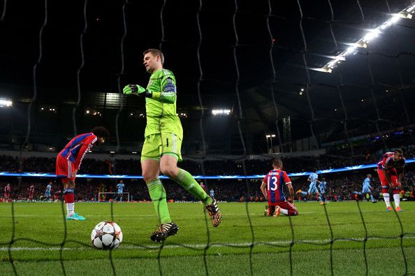 A dejected Manuel Neuer of Bayern Muenchen and teammates react after Sergio Aguero of Manchester City scores the matchwinning goal during the UEFA Champions League Group E match between Manchester City and FC Bayern Muenchen at the Etihad Stadium on November 25, 2014 in Manchester, United Kingdom.
