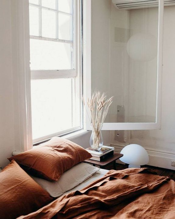 rust colored washed linen bed sheets. / sfgirlbybay