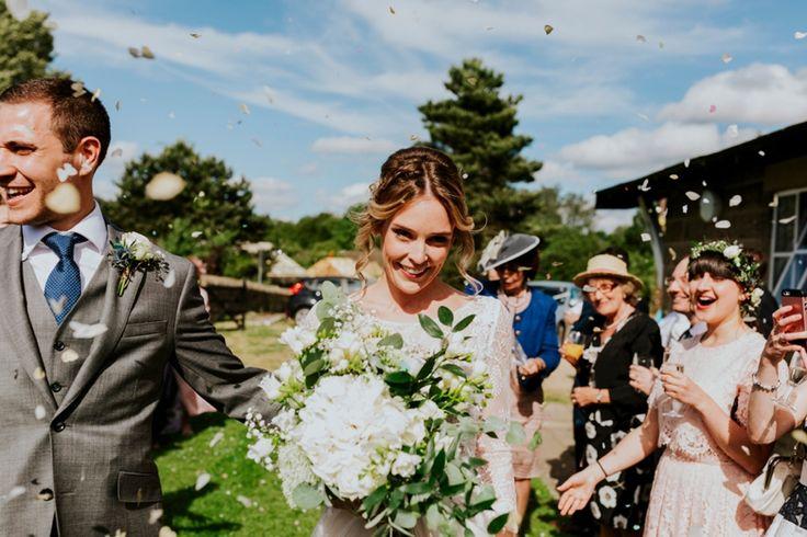 Confetti time! Photo by Benjamin Stuart Photography #weddingphotography #confetti  #countrywedding #brideandgroom #weddingflowers #bouquet #sunnywedding