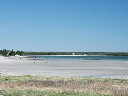 The beach at the end of the garden at A Blue House in Louis Head, #Nova Scotia