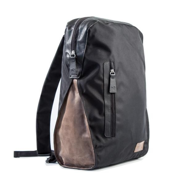 The Northwest Backpack combines distressed brown leather and black polyester for a look that's at home in business and casual settings. 100% upcycled.