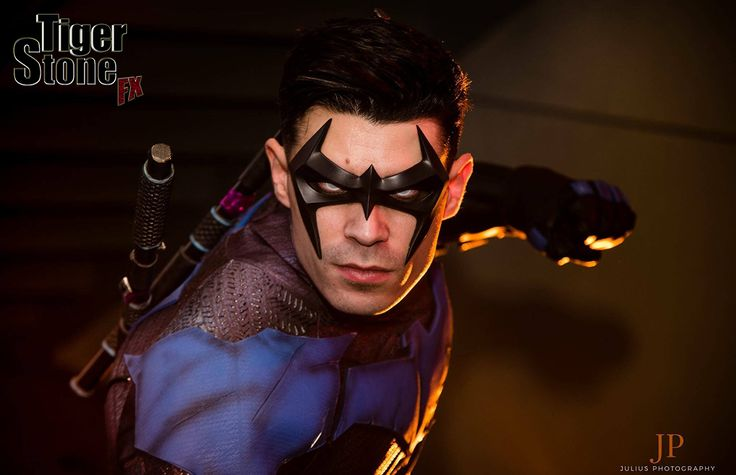 Dynamite Webber's Nightwing cosplay - wearing Tiger Stone FX Arkham City Nightwing mask, gauntlets and chest emblem - photo by Julius Photography