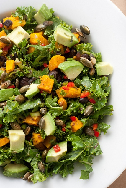 Raw kale salad with black beans and butternut squash