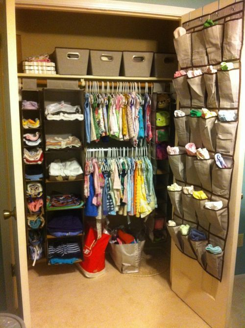 Baby's closet in nursery.  All thirty-one products :) this makes me happy because its soo orginized