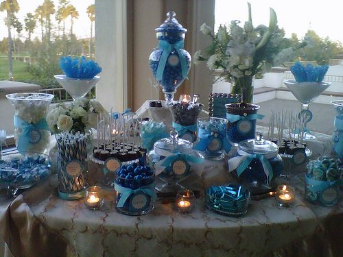 Blue and White candy buffet using various size apothecary jars.