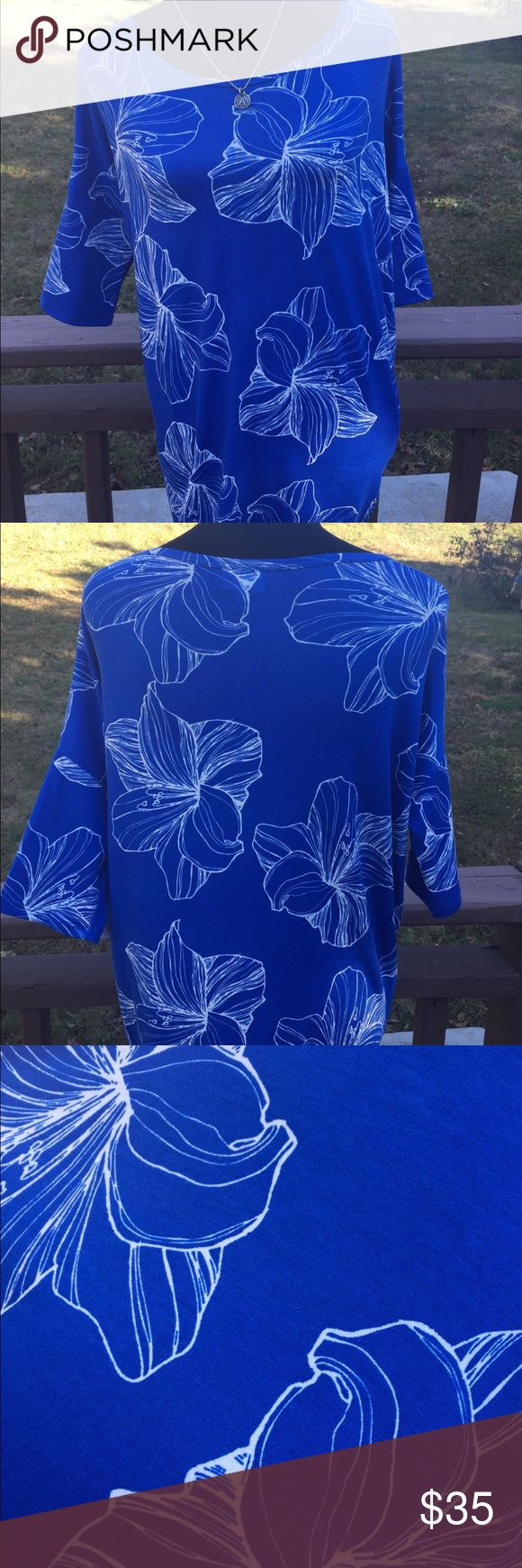 Lularoe blue and white flower Irma NWT really pretty blue and white flower Lularoe Irma, great to dress up with a pair of white jeans, dress it  up or down for a date night or work, necklace not included, pet/smoke feee Home LuLaRoe Tops Tees - Short Sleeve