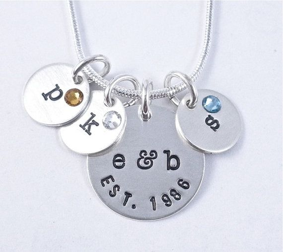 This family necklace is so sweet. Its simple and classic. The largest charm is 5/8 and features the couples initials and date. Each of these