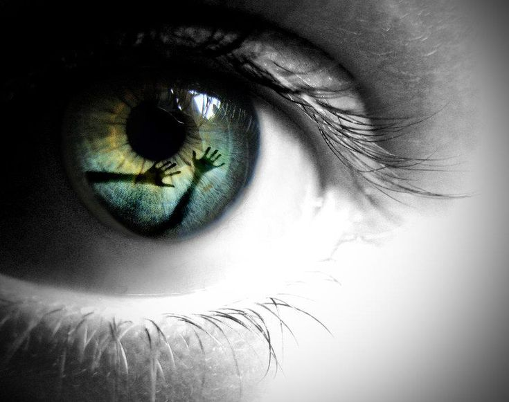 Eye Reflection eerie black and white with colored iris