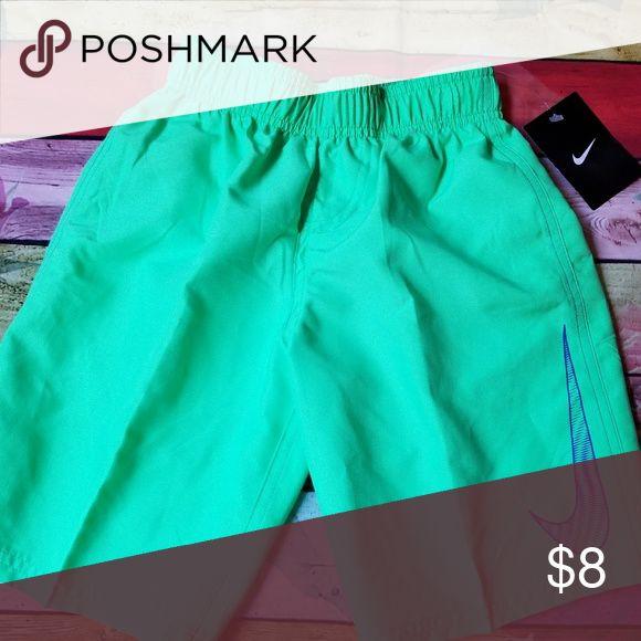 Nwt nike swim shorts trucks boys 7 New with tags Nike swim shorts BOY'S 7 Green with logo. Lined Retails at $36 Nike Swim Swim Trunks