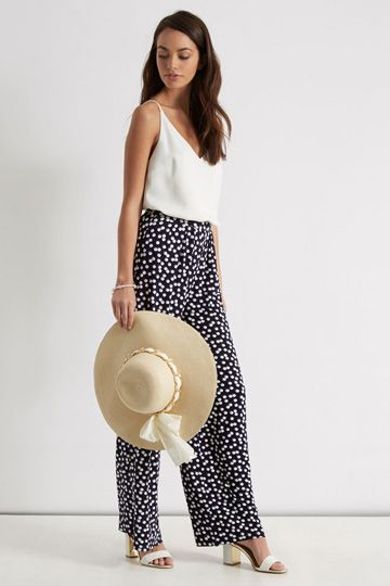 Chic, spotty and timeless – in a shape that's just wide enough to be swishy, but not so wide you lose your legs (especially important if you're a shortie like this writer…).