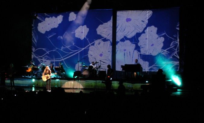 The Sheryle Crow World Concert Tour exemplifies how woven wire drapery from Cascade Coil can create stunning projection visuals.